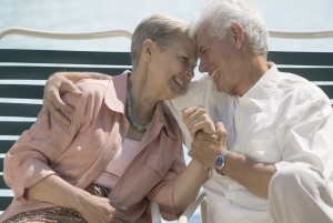Senior Couple Relaxing in Deck Chairs